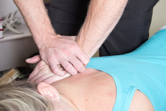Vancouver Chiropractor Adjusting A Patient