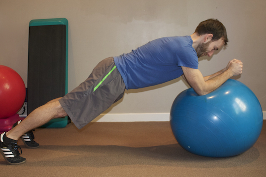 Vancouver Chiropractor and ART Provider Demonstrating Plank and Stir The Pot Core Exercise
